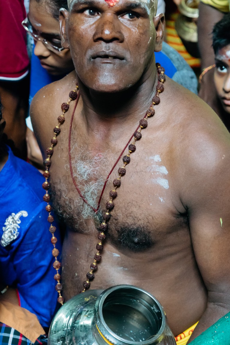 Devotees will carry their milk pots heading up the steps of Batu Caves