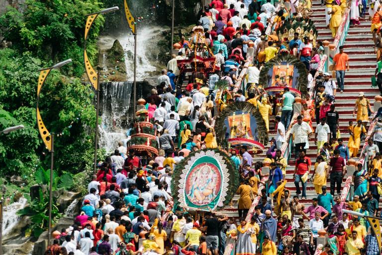Crowds ascending the 272 steps in Batu Caves