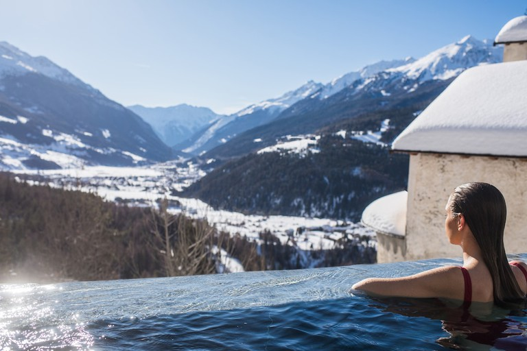 Breathtaking mountain views form the thermal infinity pool at QC Terme Bagni Vecchi, Bormio | Courtesy QC Terme Bormio