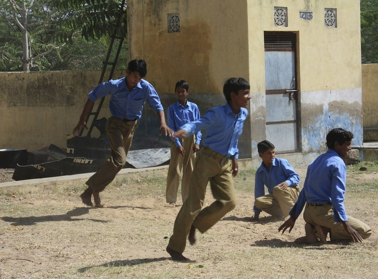 Children playing kho-kho in a government school in Haryana, India