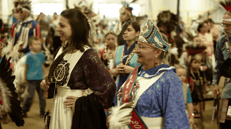 Mickela Mallozzi tries the Inter-Tribal Dance at the Lumbee Dance of the Spring Moon Pow Wow - photo by Nick Nichols