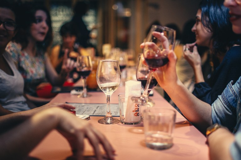 Gathering with friends around a glass of wine is a pillar of French culture