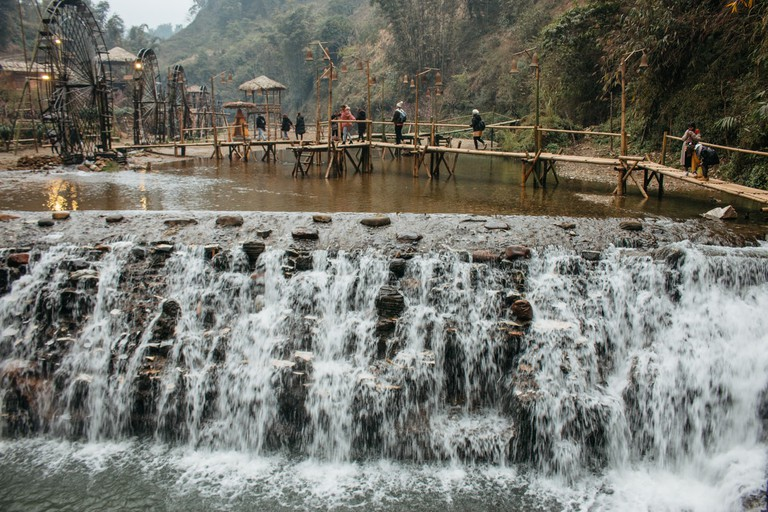 The water wheels are used to pound rice.