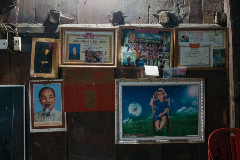 Image of President Ho Chi Minh, along with certificates of merit and photos of relatives