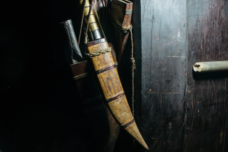 Tools used by Trà's father for forest trips and gardening