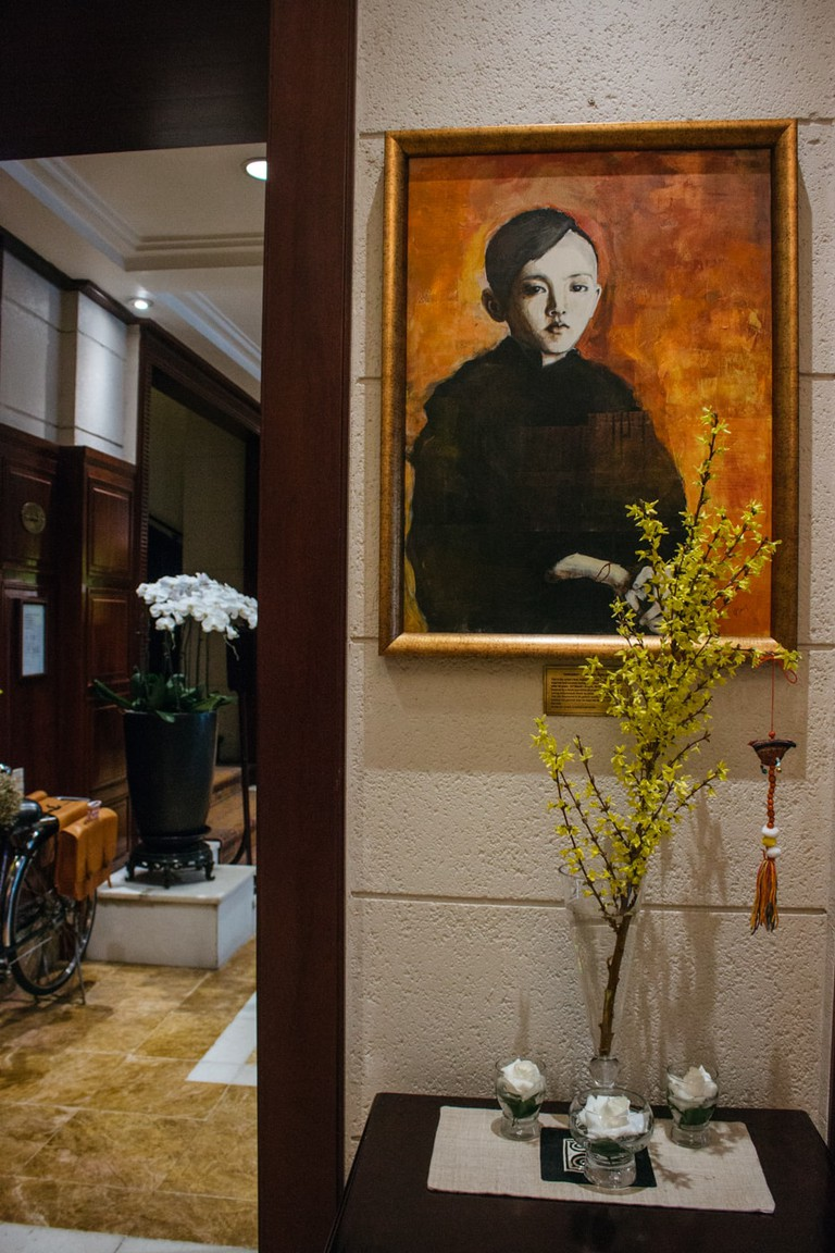 A painting of a novice monk by Joan Baez, given to the Sofitel Metropole Hotel in Hanoi