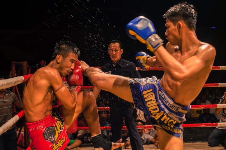 "<a href=""https://www.shutterstock.com/image-photo/udon-thani-thailand-march-13-boxer-260401664?src=G92GPC4l5Omi6oAn1QgpwA-1-42"" rel=""noopener"" target=""_blank"">Muay Thai fighters in the ring"
