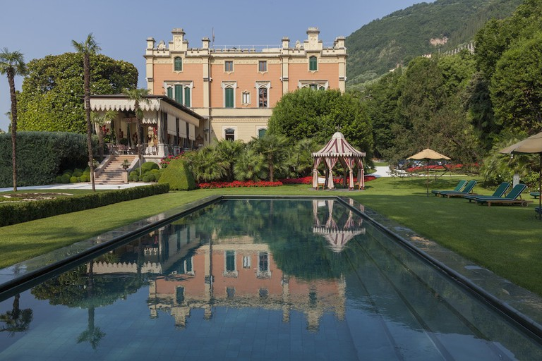 The lush poolside at Grand Hotel a Villa Feltrinelli, Lake Garda | Courtesy Grand Hotel a Villa Feltrinelli