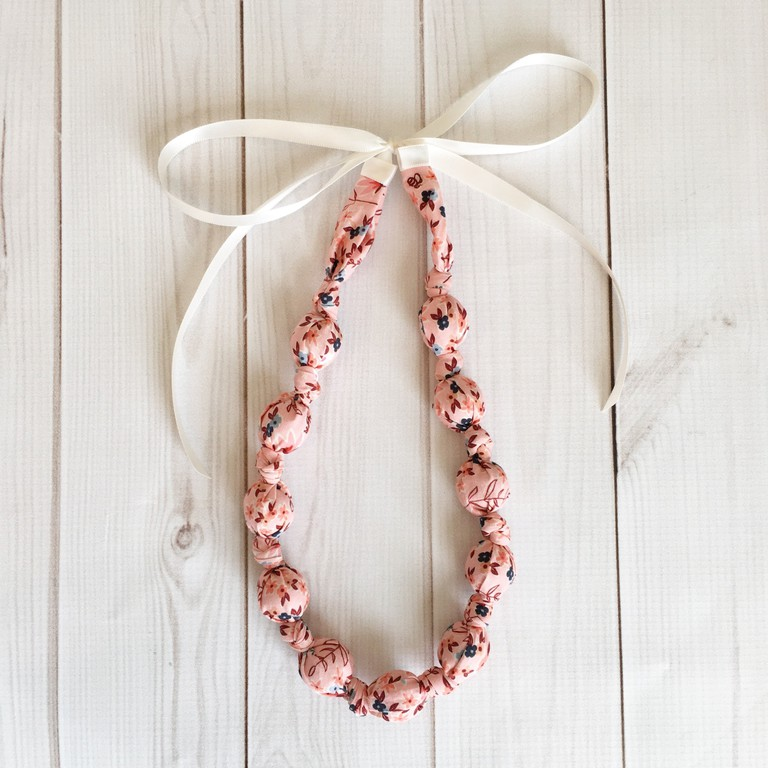 https://www.thevintagehoneyshop.com/collections/all-products/products/teething-nursing-necklace-beeutiful