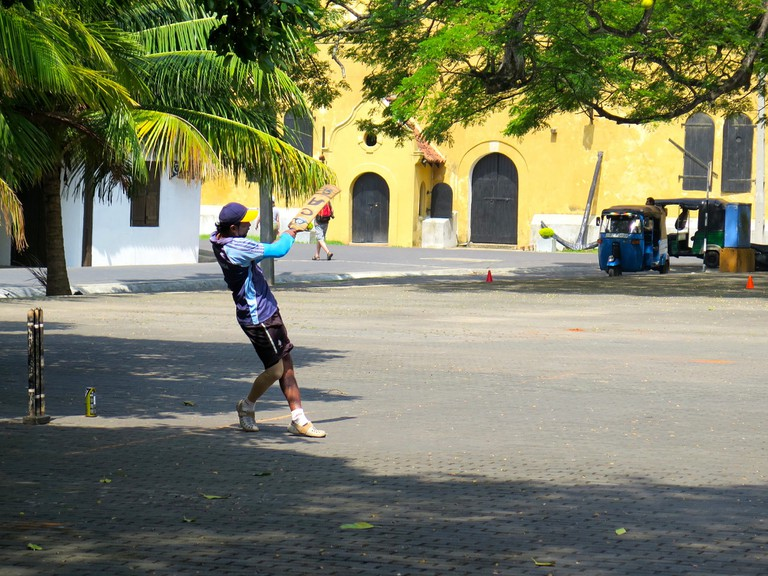 Playing street cricket in Galle