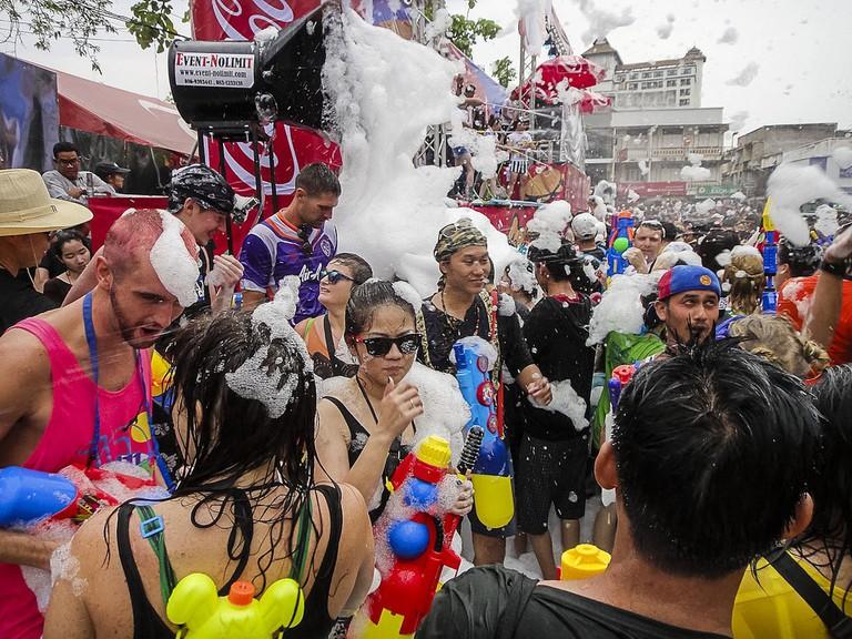 Wet and foamy Songkran revelers
