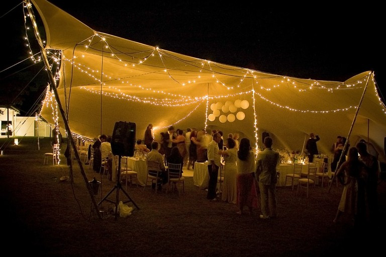 Twinkling lights in a wedding reception tent
