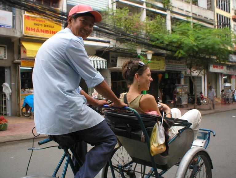 Cyclo_with_tourist_Ho-Chi-Minh-City