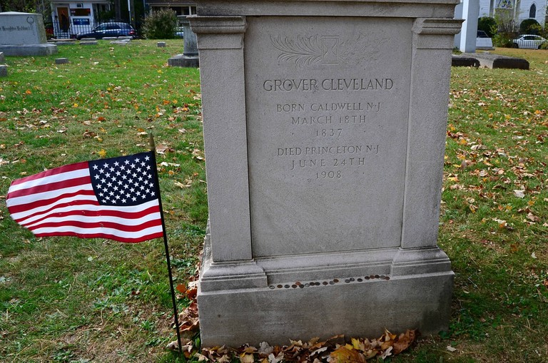 Grover Cleveland's grave in Princeton, lined with small tokens of admiration from visitors