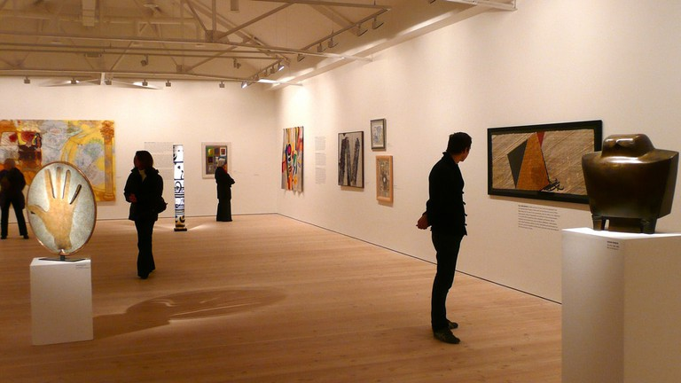 Perusing paintings at an art gallery