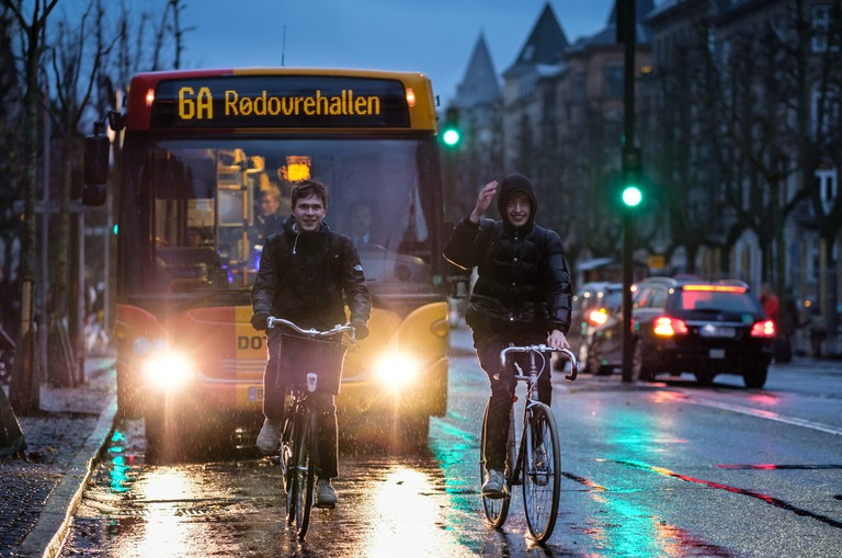 copenhagen cyclists streets rain
