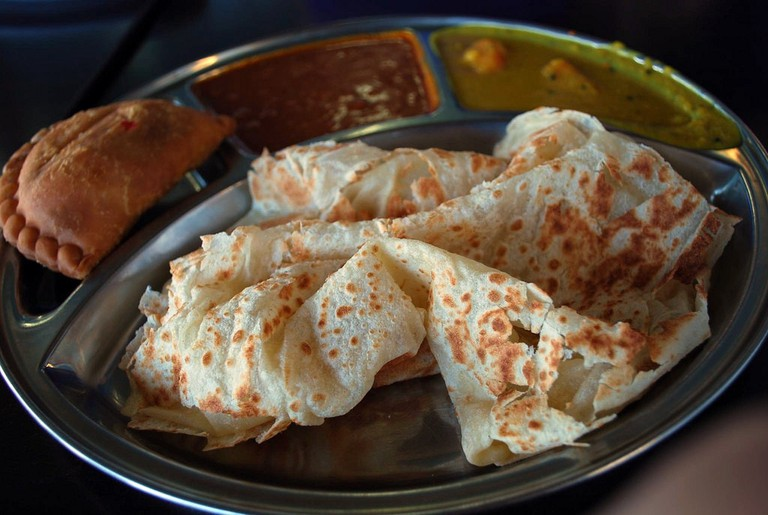 """<a href=""""https://www.flickr.com/photos/avlxyz/4635003943/"""" rel=""""noopener"""" target=""""_blank"""">Enjoy authentic Indian fare in Little India"""