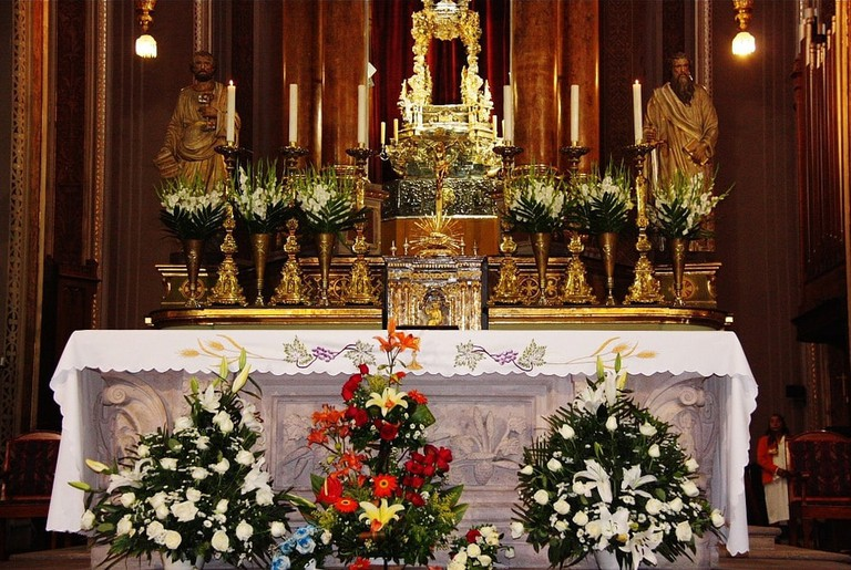 Altars on Good Friday are decorated with colourful flower bouquets