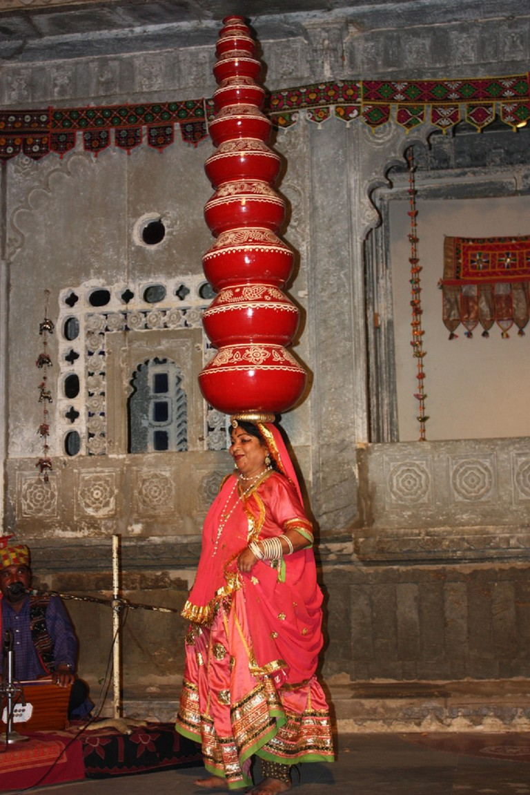 Bhavai dance involves women balancing eight to nine brass pitchers or earthen pots on their head as they dance and twirl around