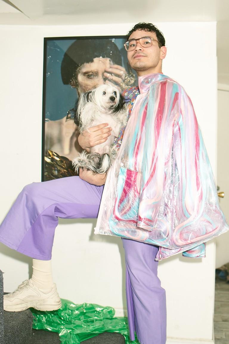 Stylist Phil Gomez with his dog Warhol