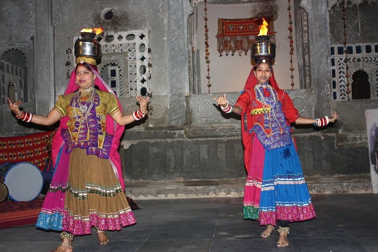 Chari is enacted only by women by balancing the lighted brass pots on their heads