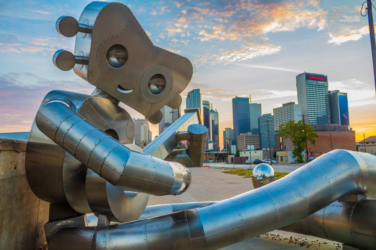 'Waiting on a Train' is the second sculpture in 'The Traveling Man' series in Deep Ellum