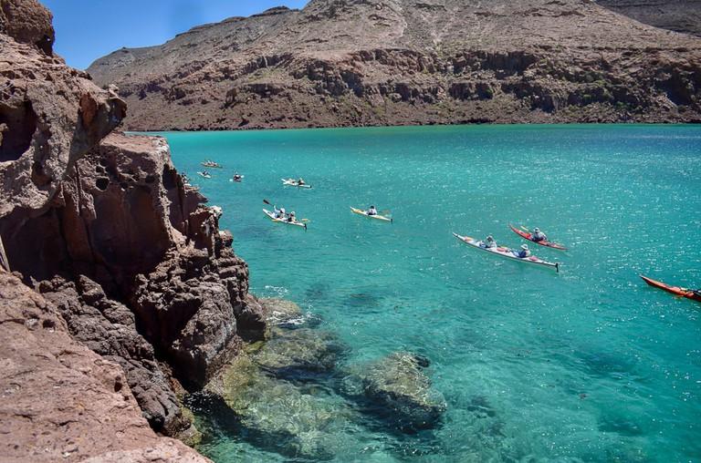 Kayaking through crystal-clear waters in Espiritu Santo