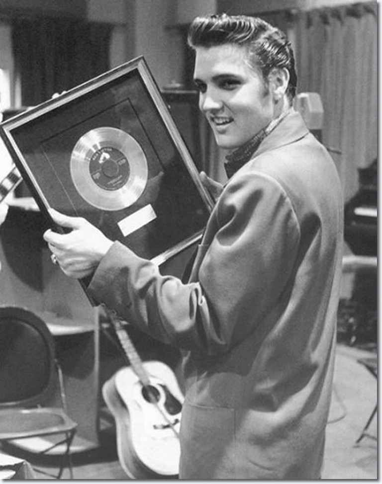 "The one millionth record of ""Heartbreak Hotel"" is presented to Elvis Presley by RCA Victor"