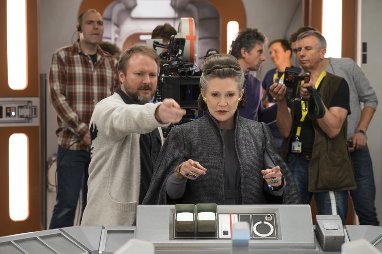 Director Rian Johnson with Carrie Fisher (Leia) on set