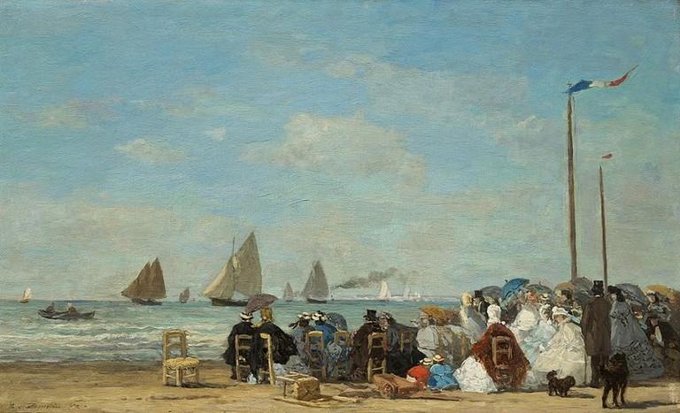 Scène de plage à Trouville by Eugène Boudin depicts the scene of wealthy Parisians sunbathing on Trouville's beaches