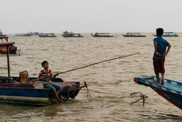 Children fish in the Tonle Sap Lake