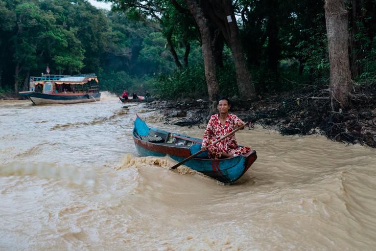 A villager heads downstream