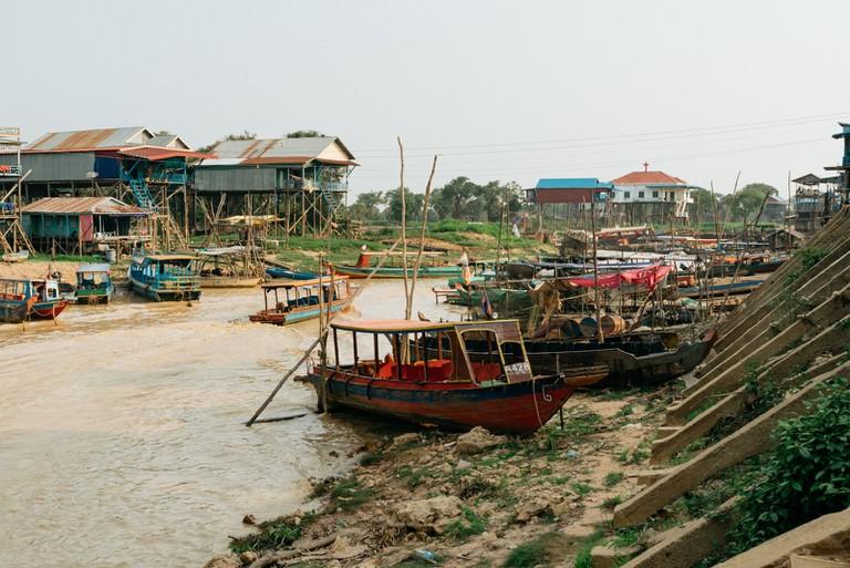 Boats sit outside homes at Kampong Phluk