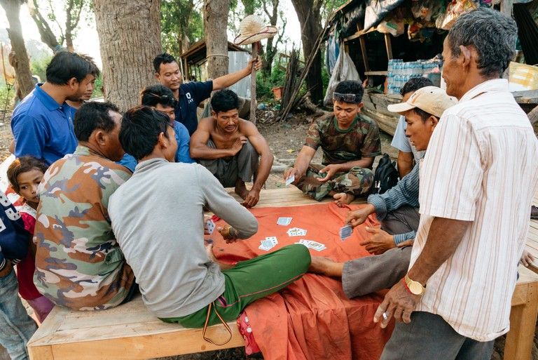 Villagers enjoy a game of cards