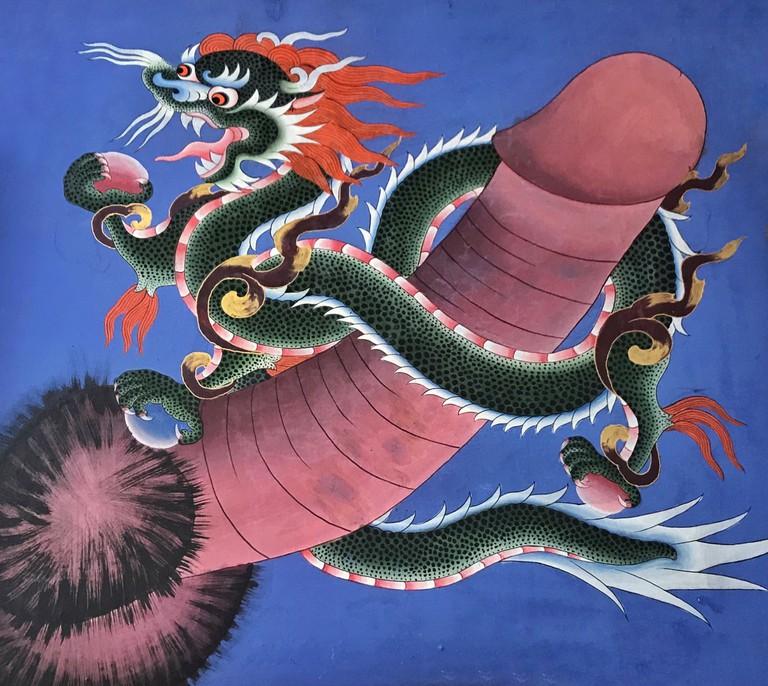 A ferocious dragon encircles a penis in a mural in Paro, Bhutan