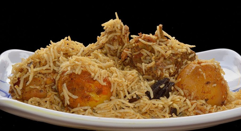 Calcutta (or Kolkata) biryani has soft boiled eggs and potatoes in it, along with meat and rice