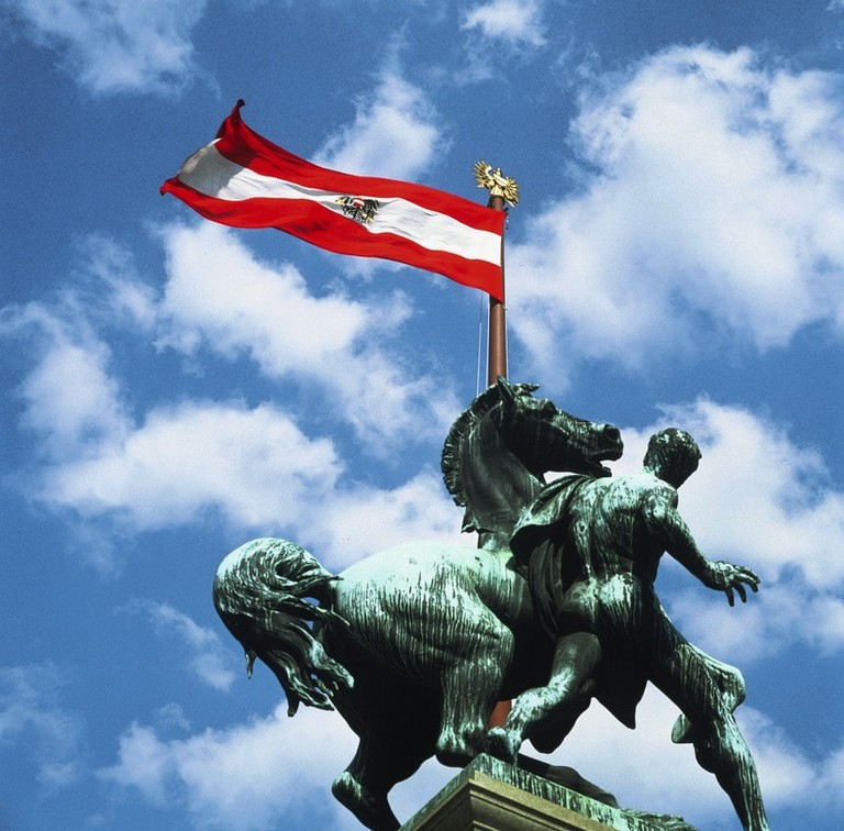 Austrian flag on a statue in Vienna