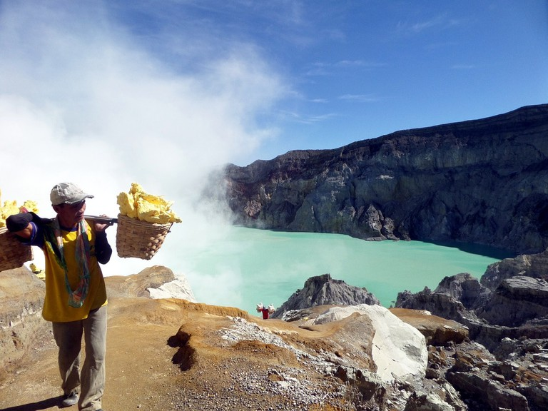 Sulfur miner at Ijen volcano