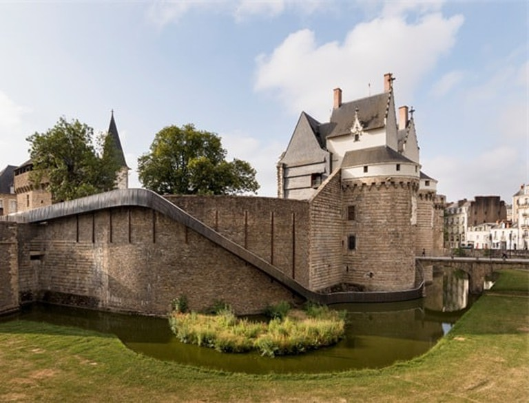 A slide adds interest to the Château des ducs de Bretagne for the Voyage á Nantes festival