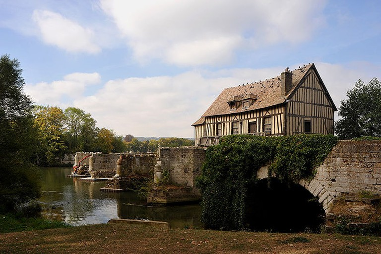 The medieval Old Mill of Vernon keeping watch over the Seine River