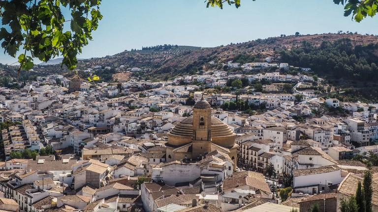 Landscape view of Iglesia de la Encarnacion church in Montefrio, Granada from the hill