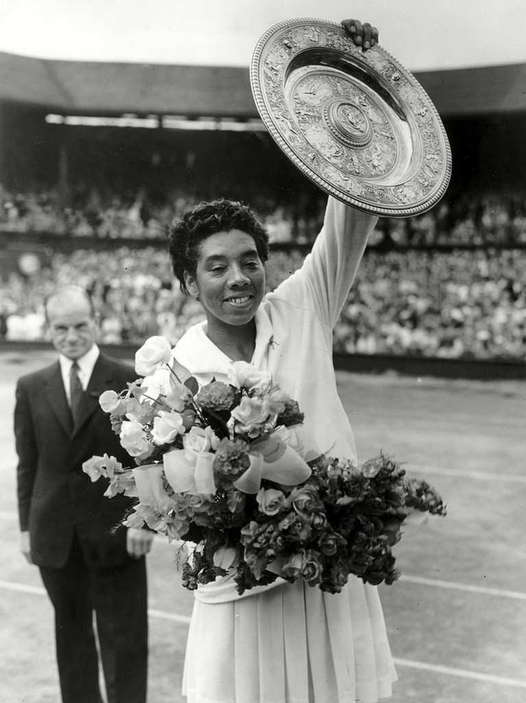 Althea Gibson winning the ladies singles title at Wimbledon in 1958.