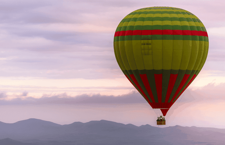 The hot air balloon starts flying over Marralesh