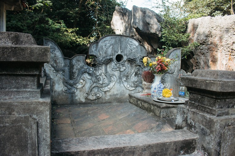 An offering of incense, fruit and flowers to the ancestors. Vu Pham Van /