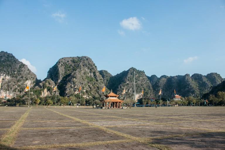 A small pagoda in Hoa Lu against the backdrop of limestone mountains. Vu Pham Van /