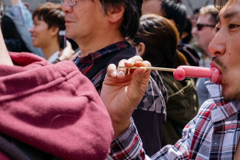 Penis-shaped lollipops are a common sight at the festival