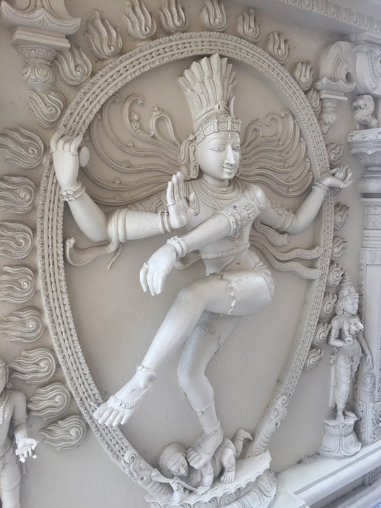 Carving of Shiva, dancing god of creation, destruction and harmonious flow, at the Hindu Temple of Florida