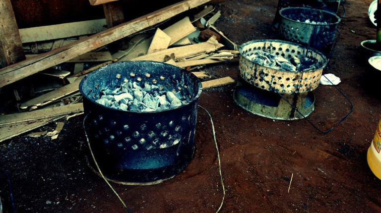 Metal outdoor grills used to cook traditional food served at a pre-wedding ceremony in Zambia