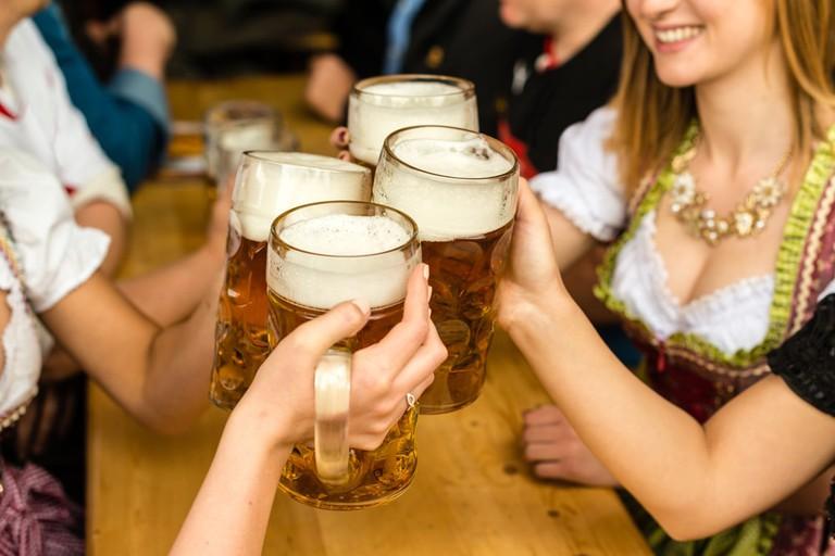 Bavarian girls in traditional Dirndl dresses at Oktoberfest | Frank Gaertner/Shutterstock