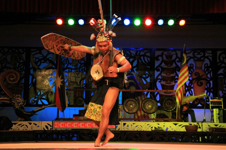 Traditional costume of an Iban warrior from Sarawak performing the Ngajat dance